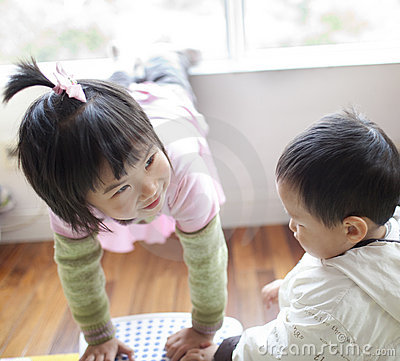 Gym chinese baby girl talk with her brother