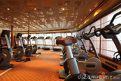 Gym hall with treadmills and exercise bicycle