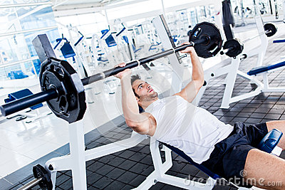 Gym man lifting weights