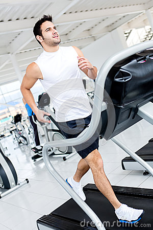 Gym man on the treadmill