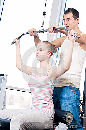 Gym man and woman doing exercise