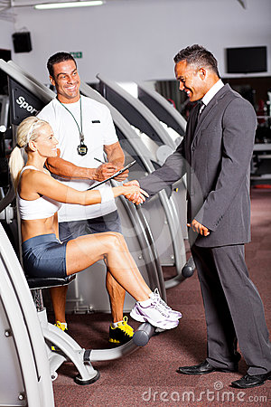 Gym manager greeting customer