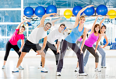 Gym people stretching