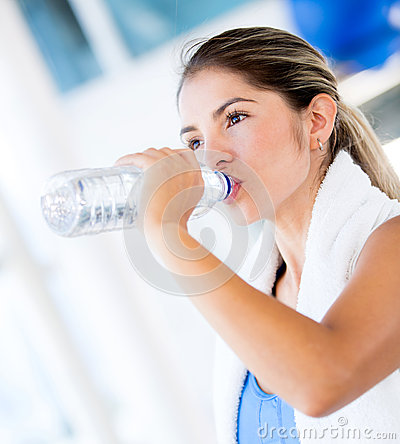 Gym woman drinking water