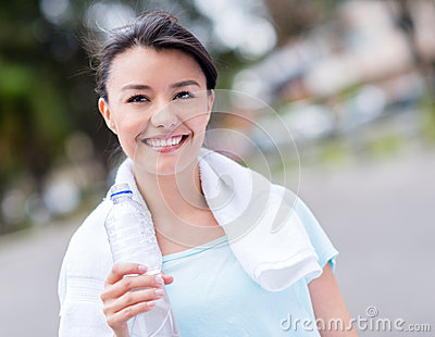 Gym woman holding water bottle