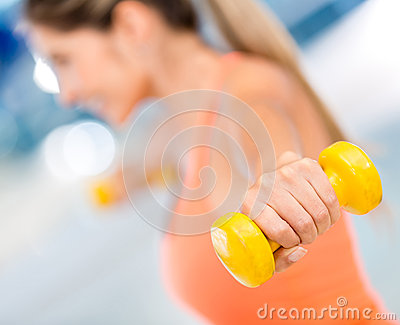 Gym woman lifting weights