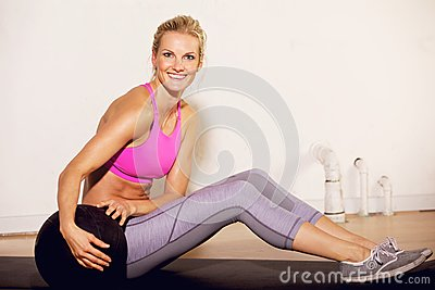 Gym Woman with a Pilates Ball