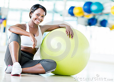 Gym woman with Pilates ball