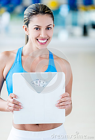 Gym woman with a weight scale
