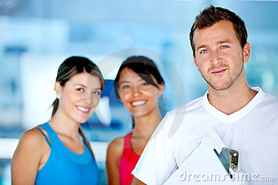 Gym women with their trainer
