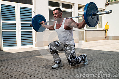 gym workout with barbell lunge stock photo  image 33972610