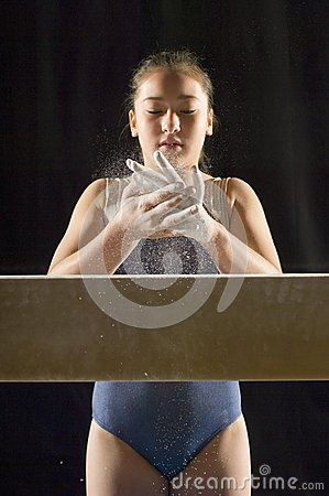 Gymnast Applying White Chalk To Hands