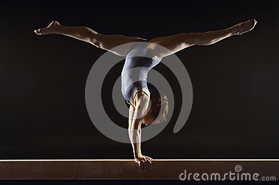 Gymnast Doing Split Handstand On Balance Beam