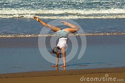Gymnast woman practice yoga on the beach