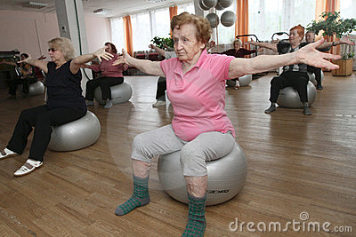 Gymnastics with ball for elders Editorial Stock Image