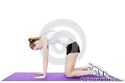 Gymnastics of female on the gymnastic carpet