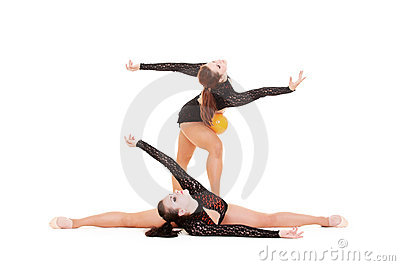 Gymnasts dancing with yellow ball