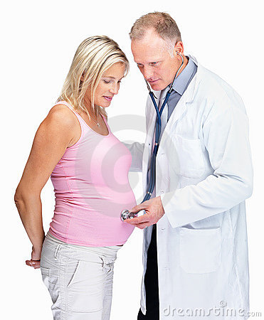 Gynecologist checking pregnant woman s belly