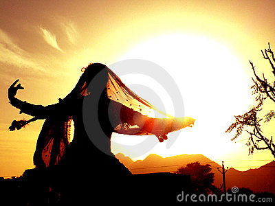 Gypsy dancer against sun