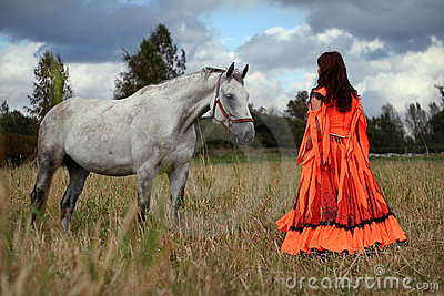 Gypsy girl with a grey horse
