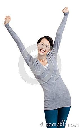 Härlig flicka som göra en gest triumphal nävar