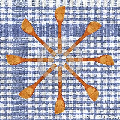 Hölzerner Löffel und Tischdecke
