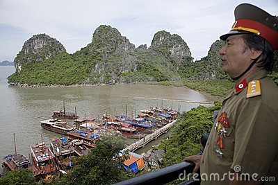 Ha Long Bay with Vietnamese officer Editorial Stock Image