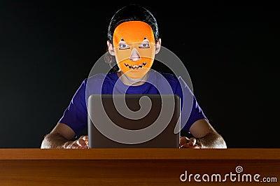 Hacker sitting in dark
