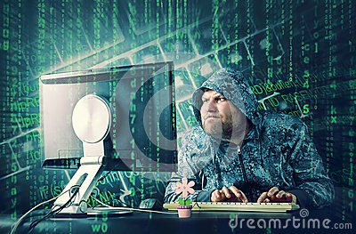 Hacker sitting at desk looking on computer screen