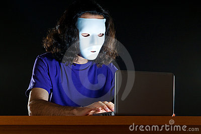Hacker sitting in  room
