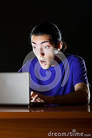 Hacker sitting in  room