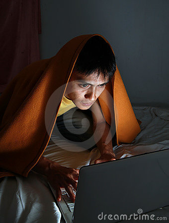 hacker working on bed