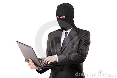 A hacker working on a laptop