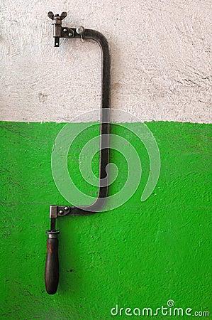 Hacksaw on obsolete wall
