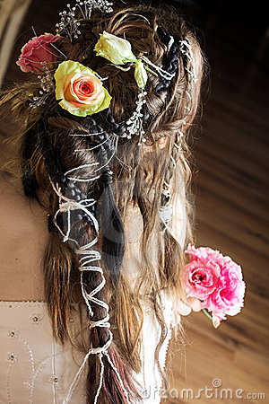 Hair of bride with flowers and beads