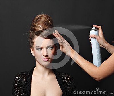 Hair spray, woman over black