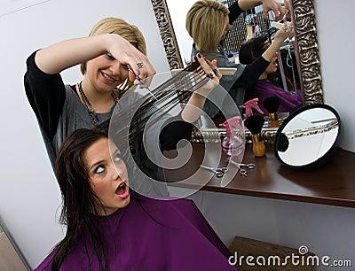 Hair stylist cuting woman hair