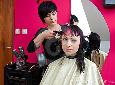 Hair stylist making cool haircut
