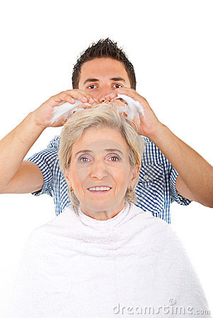Hairdresser applying hair mousse