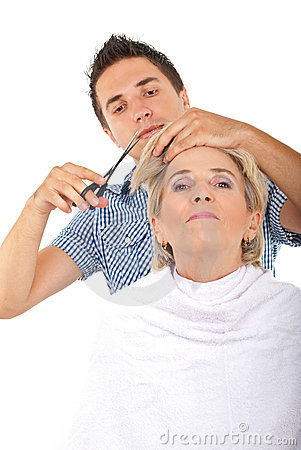 Hairdresser cut senior woman hair