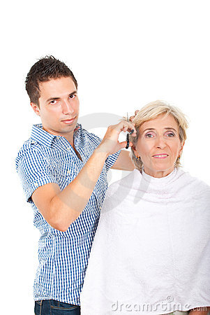 Hairdresser cutting woman hair