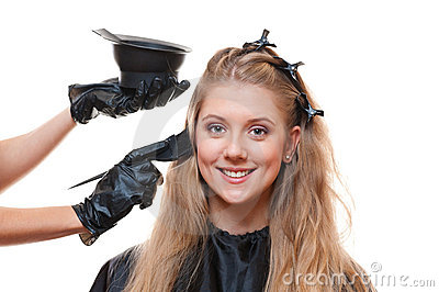 Hairdresser doing hair dye