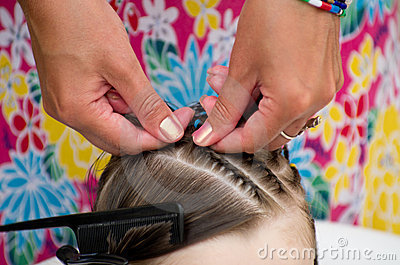 Hairdresser hands weaving a dreadlocks