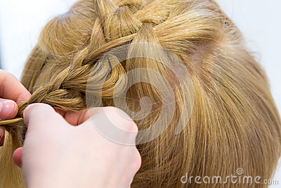 Hairdresser make braids