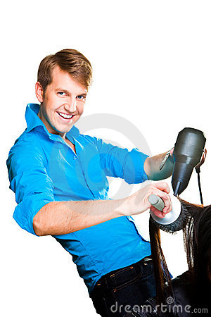 Hairdresser man drying with hair dryer on white