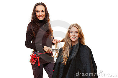 Hairdresser working with client
