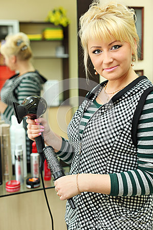 Hairdresser in workplace in beauty salon