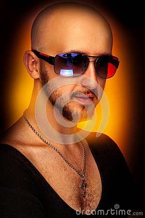 Hairless male in sunglasses looking at camera