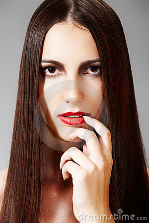 Hairstyle & make-up. Model with shiny long hair
