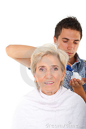Hairstylist applying hair mousse
